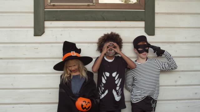 diverse boys and girls on halloween - four seasons filmów i materiałów b-roll