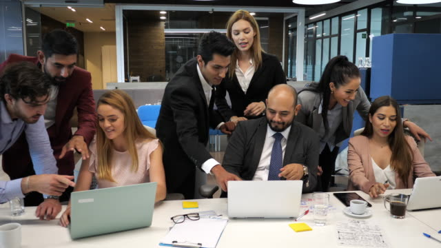 diverse business people, including latinos and hispanic business people, celebrating success on stock market ipo - cultura latino americana video stock e b–roll