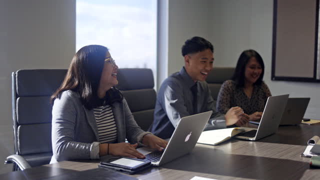 Diverse Business Team A diverse business team working together in a conference room. filipino ethnicity stock videos & royalty-free footage