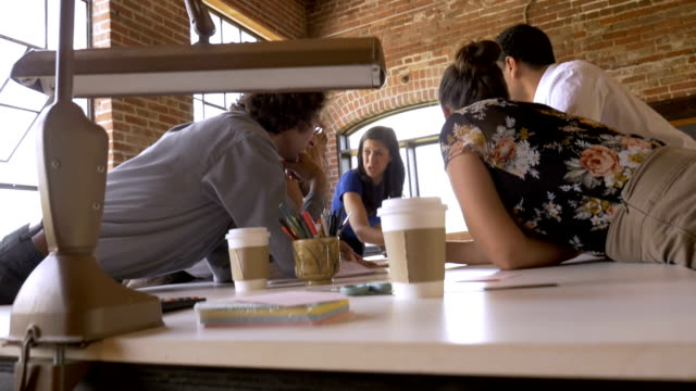 diverse collaborative startup team brainstorming during a business meeting - small business stock videos & royalty-free footage