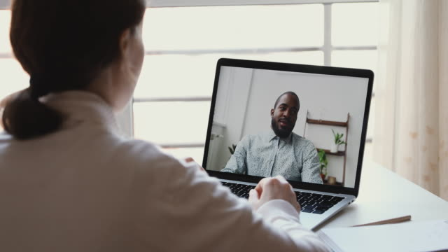 Diverse distance workers or friends communicating in virtual webcam chat
