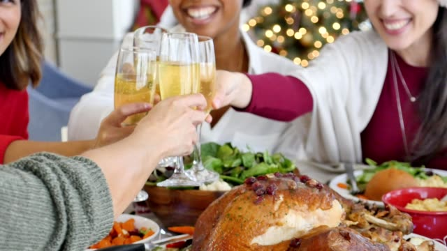 Diverse female friends enjoy traditional Christmas dinner togeter video
