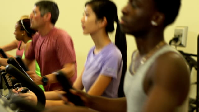 Diverse group of people working out video