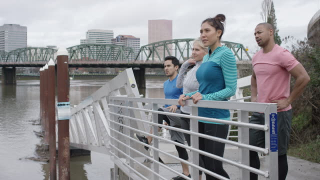 Diverse Group of Runners Take a Break to Appreciate Cityscape video