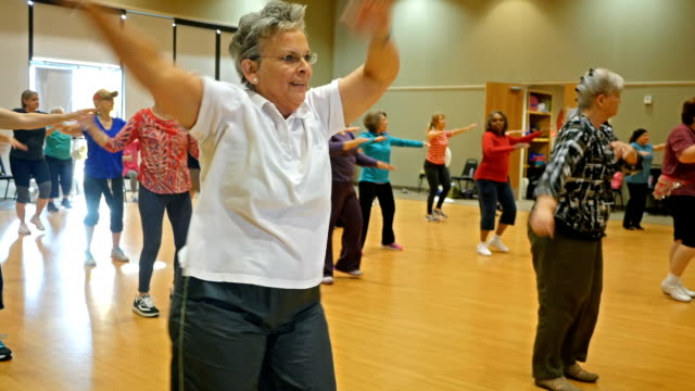 Diverse group of Senior women dancing during exercise class video