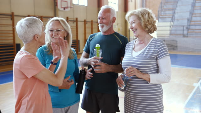 diverse group of seniors relaxing and drinking water after intense dance class - active lifestyle stock videos & royalty-free footage
