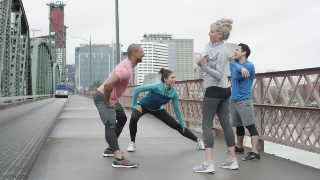 Diverse Group Stretching on a Bridge in Downtown Portland video