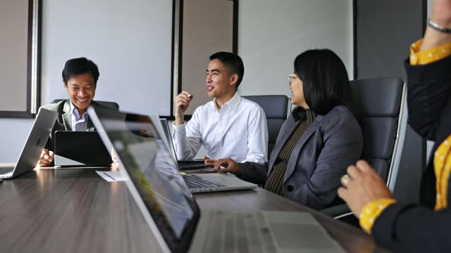 Diverse Staff Meeting in Conference Room A diverse staff has a meeting in a conference room. filipino ethnicity stock videos & royalty-free footage