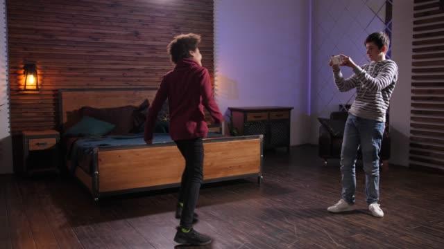 Diverse teens shooting video of dance on phone