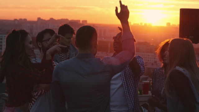 Diverse Young Friends Partying on Rooftop video