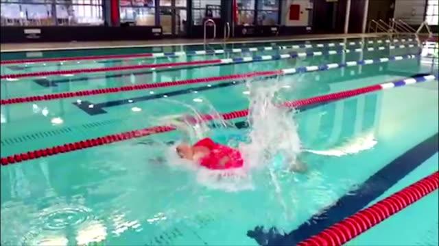 Diving Quadriplegic Swimmer Slow motion footage of a quadriplegic swimmer diving into a swimming pool. amputee stock videos & royalty-free footage