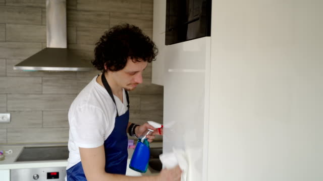 divorced young man cleaning a house video