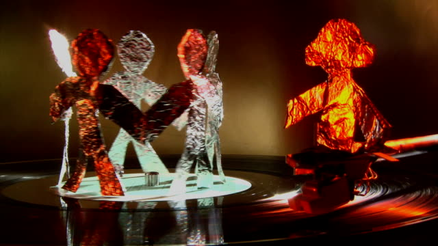 Dj and aluminum people dance on record player Deejay and aluminum made happy people dance around on record player grooved stock videos & royalty-free footage