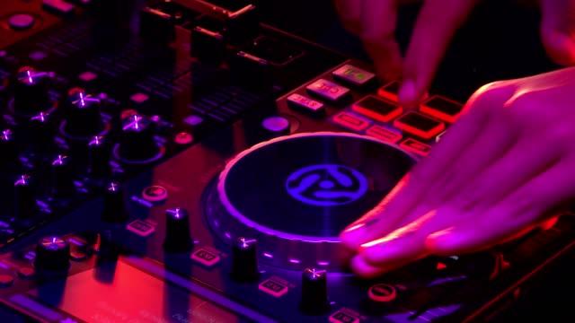 Dj mixer with headphones at a nightclub video