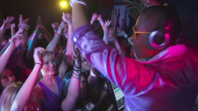 hd: dj motivating guests to dance - latino music bildbanksvideor och videomaterial från bakom kulisserna