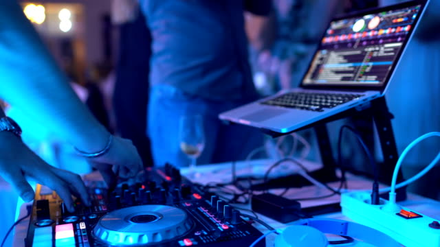 Dj playing music on night party - video