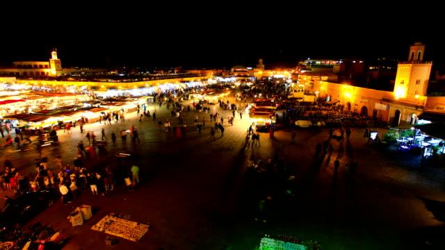 djemma el fna a marrakech, in marocco, a notte, time lapse video - souk video stock e b–roll