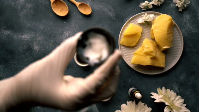 Do It Yourself - Making of Homemade Organic Hand Cream - Mango Butter DIY - Making of homemade organic hand cream from natural ingredients. mango stock videos & royalty-free footage
