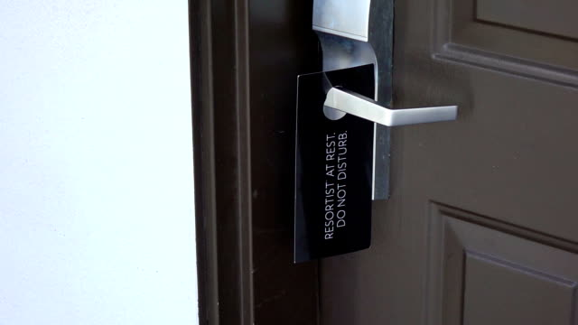 Do not disturb door sign in slow motion video