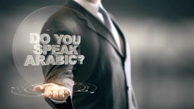 Do You Speak Arabic Businessman Holding in Hand New technologies