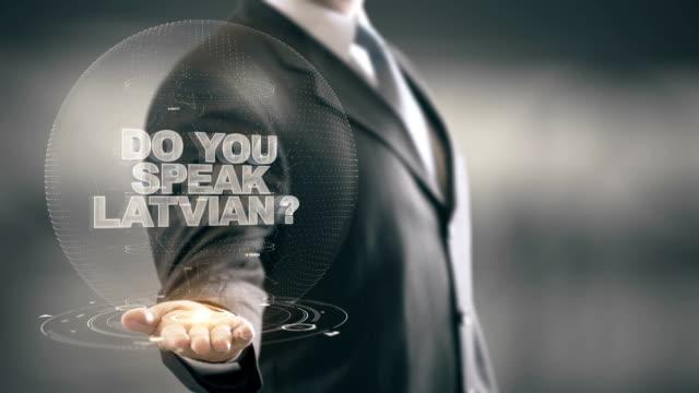 Do You Speak Latvian Businessman Holding in Hand New technologies