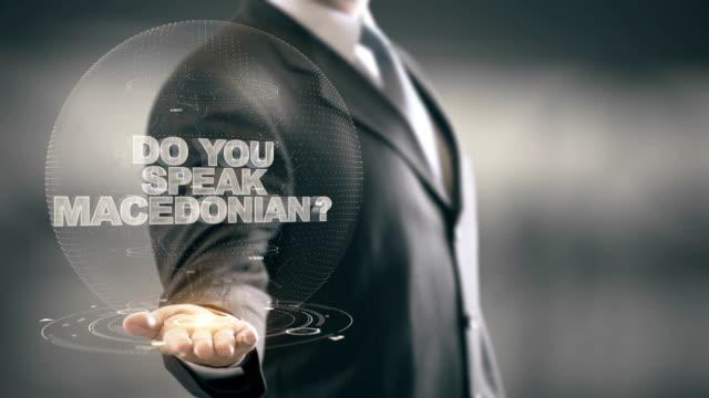 Do You Speak Macedonian Businessman Holding in Hand New technologies