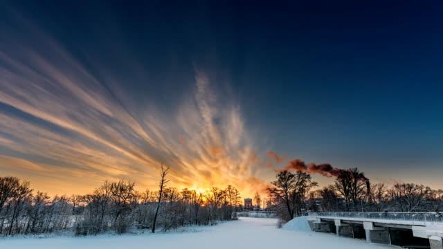 dobrush, gomel region, belarus. time lapse timelapse time-lapse of old paper factory tower in winter morning. sun in sunrise over historical heritage - estonia video stock e b–roll