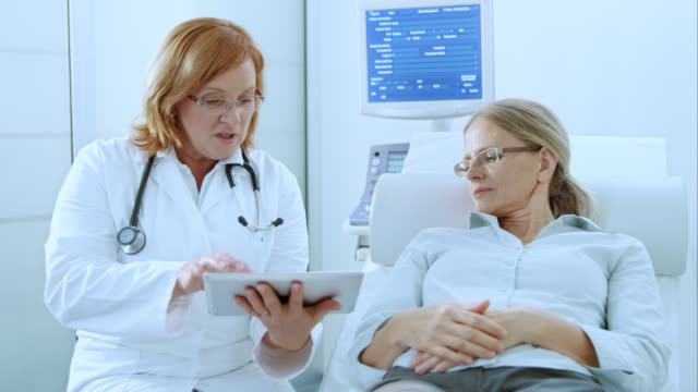 Doctor advising patient with the help of tablet video