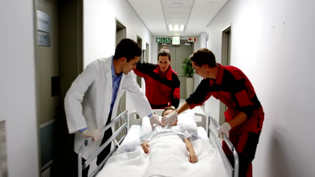 Doctor and paramedics rushing a patient to emergency room video