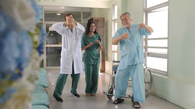 Doctor and patient dance together at hospital video