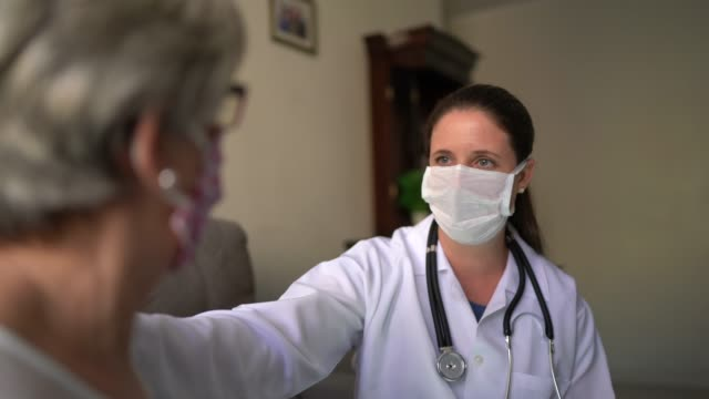 Doctor and patient on medical consultation at patient's house video