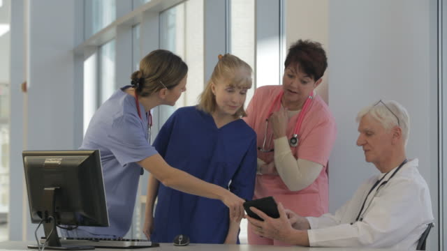 Doctor and three nurses in conference video