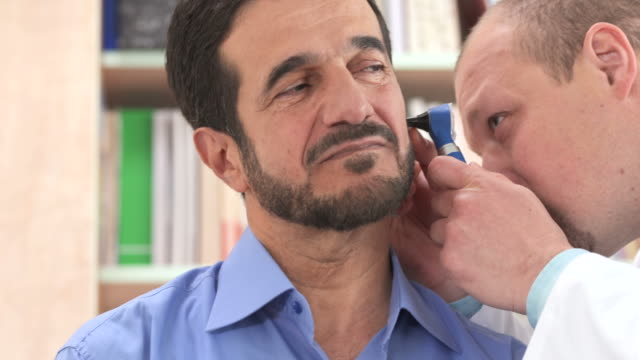 stockvideo's en b-roll-footage met hd: doctor checking ear infections - ear
