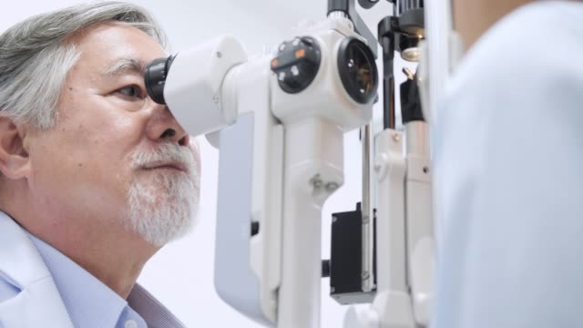 Doctor checking eyes with biomicroscope device 4K. Dolly shot of  doctor examining eye structure with help of medical equipment. Professional health care. Doctor checking eyes with biomicroscope device 4K. Dolly shot of  doctor examining eye structure with help of medical equipment. Professional health care. eye exam stock videos & royalty-free footage