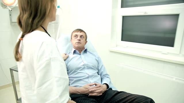 Doctor communicating with client in the hospital video
