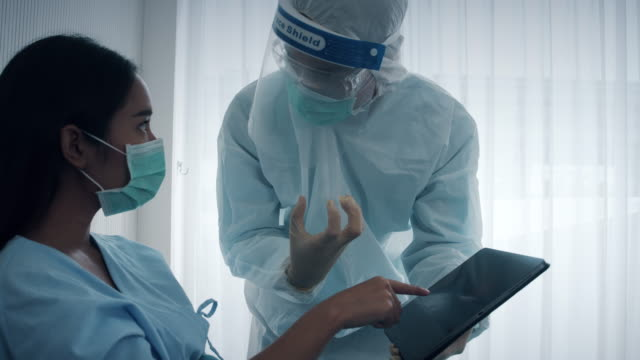 Doctor diagnose to patient on bed.