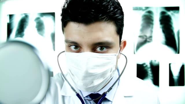 Doctor Examining Camera Delivering Bad News Concept video