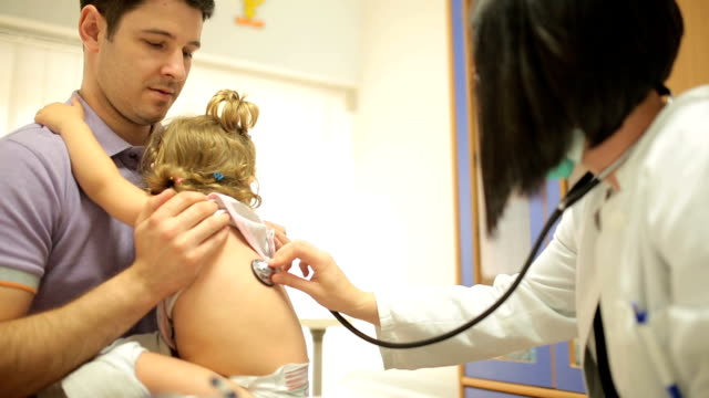 Doctor examining child video