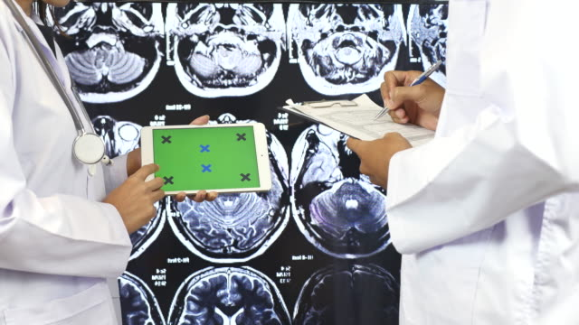 Doctor explaining on Digital tablet to Another doctor with Green screen, Green screen video
