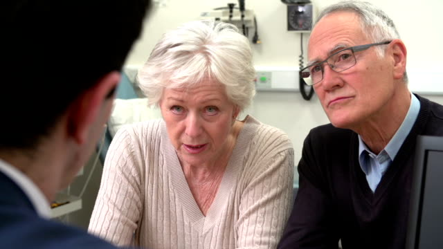 Doctor Having Discussion With Senior Couple In Surgery video