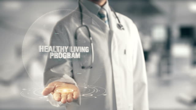 doctor holding in hand healthy living program - icon set healthy video stock e b–roll