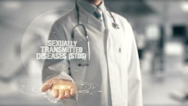 Doctor holding in hand Sexually Transmitted Diseases STDs video