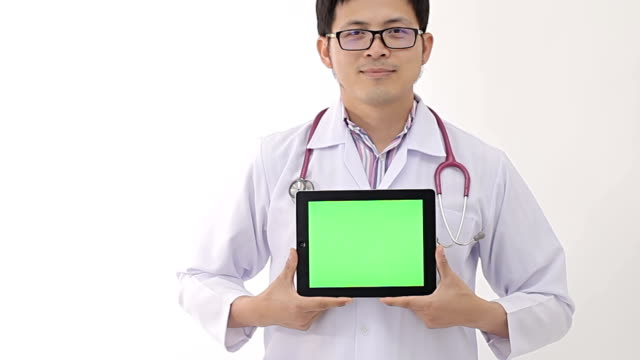 Doctor holding laptop against with green screen video