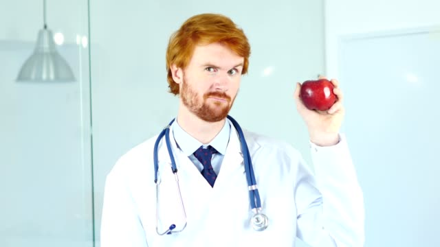 Doctor Holding Red Apple to Express Healthy Lifestyle video