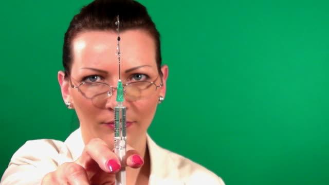 Doctor holding syringe video