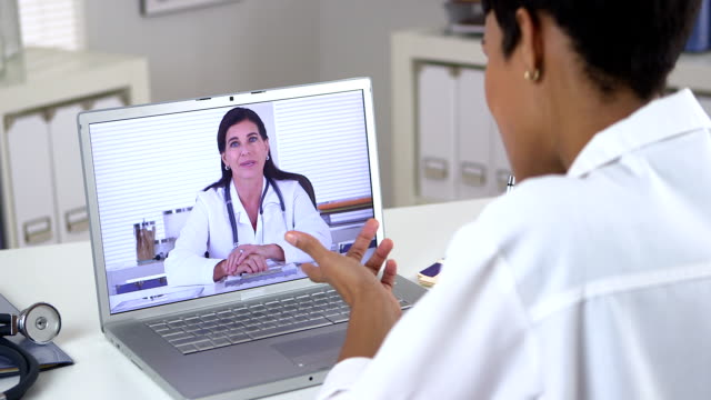 Doctor holding video conference with colleague video
