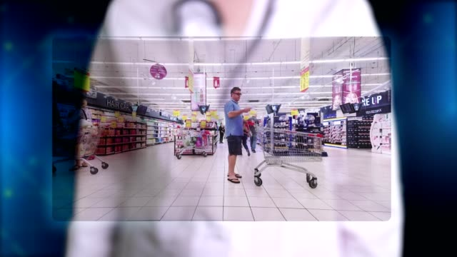 Doctor, in blue medical gloves, presents hologram image of supermarket shopping. Doctor makes freeze frame, puts stamp - quarantine. Prohibitions during coronavirus epidemic - vídeo
