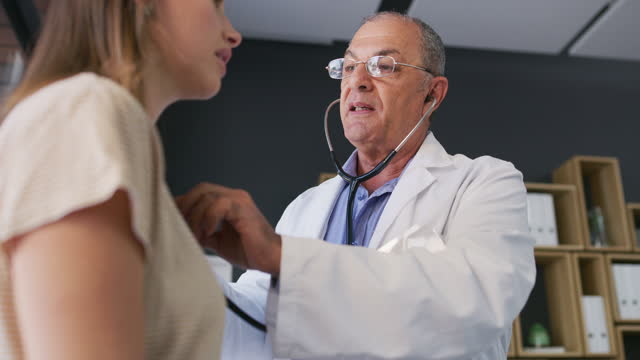 A doctor knows how to listen to what the body is saying 4k video footage of a mature doctor examining a patient with a stethoscope cardiologist stock videos & royalty-free footage