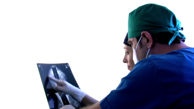 Doctor looks at x-rays Doctor looks at x-rays HD 1080i. mammogram stock videos & royalty-free footage