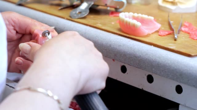 A doctor makes false teeth in the dental laboratory video